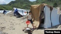 수해를 입은 북한 평안남도 성천군의 한 마을.