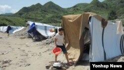지난 2012년 폭우로 폐허가 된 북한 평안남도 성천군 마을. (자료사진)