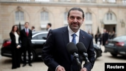 Saad al-Hariri, who announced his resignation as Lebanon's Prime Minister while on a visit to Saudi Arabia, talks to journalists after a meeting with the French President at the Elysee Palace in Paris, France, Nov. 18, 2017.