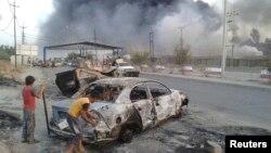 Cảnh tàn phá trong cuộc Giao tranh giữa lực lượng an ninh Iraq và nhóm Quốc gia Hồi giáo Iraq và vùng Cận đông ở Mosul, 10/6/14