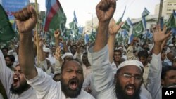 Supporters of the Pakistani religious party Jamaat-e-Islami chant slogans during a rally against drone strikes in the country's tribal areas in Karachi, Pakistan, June 5, 2011