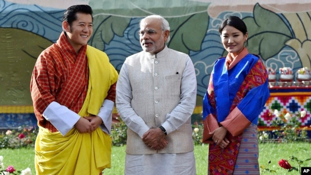 Visiting Indian Prime Minister Narendra Modi, stands with Bhutan's King Jigme Khesar Namgyel Wangchuck, left and Queen Jetsun Pema, right, during a ceremonial reception at Royal Palace in Thimphu, Bhutan, June 15, 2014.
