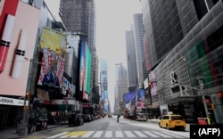 An almost empty street is seen at Times Square in New York City. The city was under a lockdown order on March 16, 2020.
