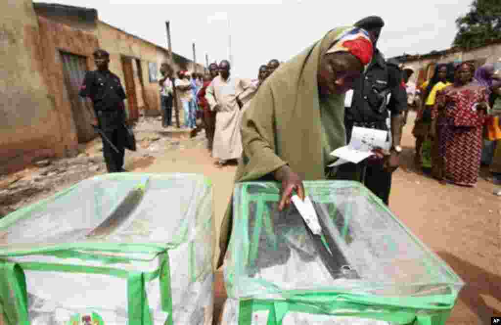 A woman prepares to cast her vote in Kaduna, Nigeria, Thursday, April 28, 2011. Small crowds of voters nervously cast ballots Thursday in two states in oil-rich Nigeria hit hard by religious rioting that killed at least 500 people following the nation's