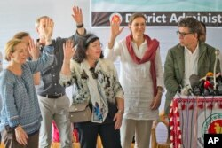 Members of the U.N. Security Council team visiting Bangladesh raise their hands during a press conference at the Kutupalong Rohingya refugee camp in Kutupalong, Bangladesh, April 29, 2018. The diplomats, were responding to a question from a journalist who asked how many of them believed that the people in the camps are Rohingyas.
