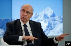 Brazil's Economy Minister Henrique Meirelles speaks during a panel discussion at the annual meeting of the World Economic Forum in Davos, Switzerland, Jan. 18, 2017.