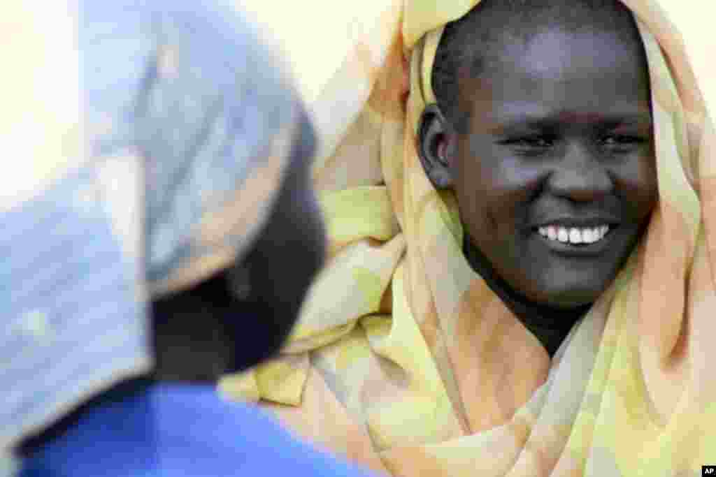 A Ngok Dinka woman, who spent years in exile in the North, shows her happiness at being reunited with her family and friends in Abyei.