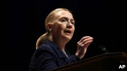 Secretary of State Hillary Rodham Clinton gestures as she gives a speech in Dublin.