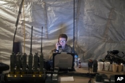 A U.S. Air Force service member uses radio communication at the command and control center inside a coalition air base in Qayyarah, some 50 kilometers south of Mosul, Iraq, Oct. 28, 2016. The U.S. military says Iraqi forces have retaken 40 villages from the Islamic State group near Mosul since a massive operation to drive the militants from the city began last week.