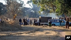 A group pf Zanu PF members camp outside Zimbabwe's deputy Minster of Labour, Tracy Mutinhiris farm in Marondera about 120 kilometres east of Harare. The group tried to take over her farm following allegations that she is sympathetic to Zimbabwes Prime Mi