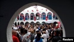Tunisian Jews and Muslims attend a ceremony at Ghriba, the oldest Jewish synagogue in Africa, during an annual pilgrimage in Djerba, Tunisia, May 2, 2018.