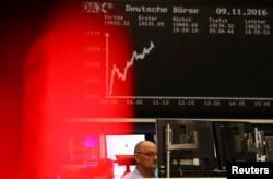 A trader at the Frankfurt stock exchange reacts in Frankfurt, Germany, Nov. 9, 2016.
