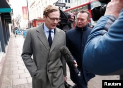 FILE - Alexander Nix, CEO of Cambridge Analytica, arrives at the offices of Cambridge Analytica in London, March 20, 2018.