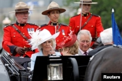 Camilla, Duchess of Cornwall, and Britain's Prince Charles arrive on Parliament Hill during Canada Day celebrations as the country marks its 150th anniversary since confederation, in Ottawa, Ontario, July 1, 2017.