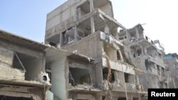 View of buildings damaged by what activists said were missiles fired by a Syrian Air Force fighter jet of forces loyal to Syria's President Bashar al-Assad at Douma near Damascus December 17, 2012.