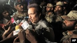 Pakistani Interior Minister Rehman Malik briefs the media in Karachi, Pakistan, May 23, 2011