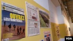 Reports in newspapers describe Europe's current migrant crisis. (L. Bryant/VOA)