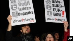 "FILE - People shout slogans as they hold placards that read ""stop censorship"" during a rally in Ankara, Turkey."