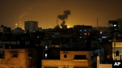 Smoke rises after an Israeli missile strike in Beit Lahia, northern Gaza Strip, July 7, 2014.