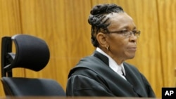 FILE - Judge Thokozile Masipa listens in court in Pretoria, South Africa in the case against Oscar Pistorius.