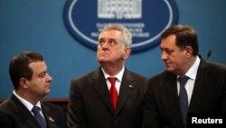 Serbian President Tomislav Nikolic, center, with Serbian Prime Minister Ivica Dacic, left, and President of Republika Srpska Milorad Dodik, Banja Luka, Bosnia, Dec. 26, 2012.