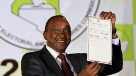 President-elect Uhuru Kenyatta displays the certificate from Independent Electoral and Boundaries Commission (IEBC) declaring him the winner of the country's presidential election in Nairobi, Mar. 9, 2013.