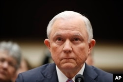 FILE - Attorney General Jeff Sessions listens at the beginning of a House Judiciary Committee hearing on Capitol Hill, Nov. 14, 2017 in Washington.