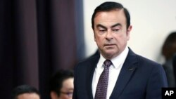 FILE - Then-Nissan Motor Co. President and CEO Carlos Ghosn arrives for a joint press conference with Mitsubishi Motors Corp. in Yokohama, near Tokyo, May 12, 2016.