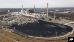 A large field of coal is stored on the property of Dominon Energy's Chesterfield Power station in Chester, Virginia., Dec. 4, 2017. The station is a coal fired power station along the James River.