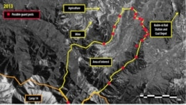 A satellite image of Ch'oma-Bong valley, North Korea, shows possible guard posts around Camp 14. (Digital Globe 2013)