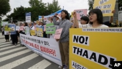 FILE - Protesters shout slogans during a rally to denounce deploying the Terminal High-Altitude Area Defense, or THAAD, in front of the Defense Ministry in Seoul, South Korea, Wednesday, July 13, 2016. President Park said North Korea's growing ballistic missile capabilities left the government no choice but to deploy the system.