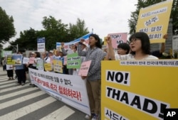 FILE - Protesters shout slogans during a rally to denounce deploying the Terminal High-Altitude Area Defense, or THAAD, in front of the Defense Ministry in Seoul, South Korea, July 13, 2016.