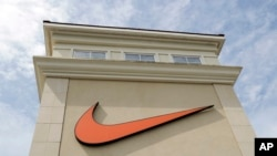 FILE - A Nike logo is displayed outside a Nike store in Charlotte, N.C., Sept. 4, 2018.