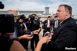 FILE - U.S. Secretary of State Mike Pompeo speaks to members of the media following two days of meetings with Kim Yong Chol, a North Korean senior ruling party official and former intelligence chief, before boarding his plane at Sunan International Airport in Pyongyang, North Korea, July 7, 2018.