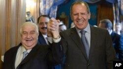 Сергій Лавров вітає міністра Валіда Муаллема у Москві
