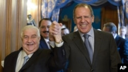 Valid al-Moalem (levo) sa Sergejom Lavrovom pre današnjih razgovora u Moskvi