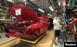 FILE - The frame of a 2015 Ford Mustang vehicle moves down the production line at the Ford Motor Flat Rock Assembly Plant in Flat Rock, Michigan, U.S. Aug. 20, 2015.