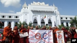 Myanmar Buddhist monks display anti-OIC banners during a rally in Yangon