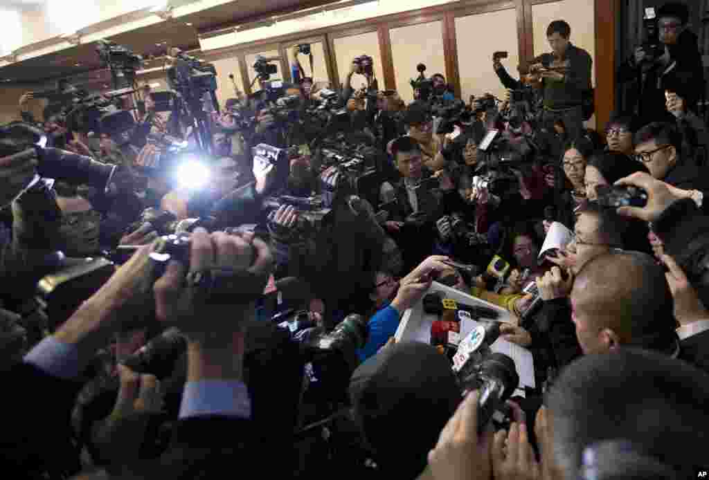 A spokesperson, right, from the Malaysia Airlines speaks to the media during a news conference at a hotel in Beijing, China. Search teams across Southeast Asia scrambled to find a Malaysia Airlines Boeing 777 with 239 people on board that disappeared from air traffic control screens over waters between Malaysia and Vietnam early morning.
