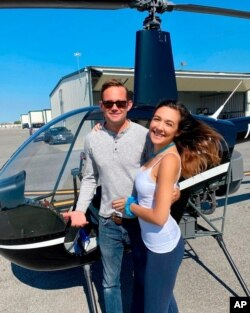This undated photo provided by John Pilkington shows helicopter pilot Joel Boyer and his fiancee, Melody Among, at John C. Tune airport in Nashville, Tennessee.