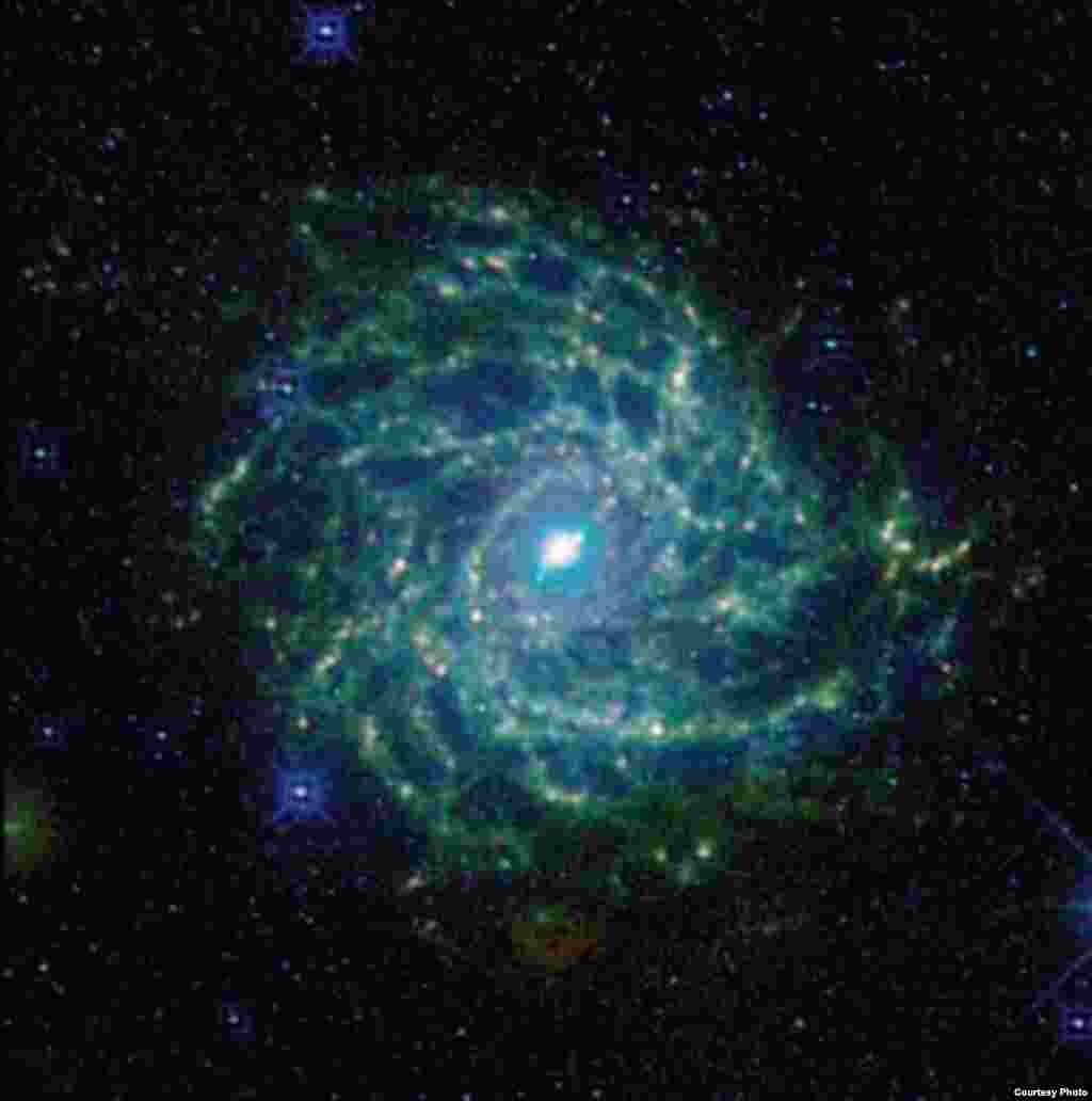 The Milky Way's 'backbone' structure contains about 100,000 stars' worth of gas and dust. (Jarret et al. 2012 Wise Enhanced Resolution Galaxy Atlas)