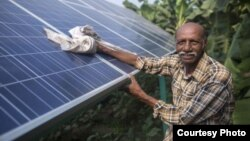 Ramanbhai Parmar has become the first farmer to sell energy back to the power grid from the solar panels that drive his water pump in Anand district, Gujrat, India, June 8, 2015. (International Water Management Institute photo, Prashanth Vishwanathan)