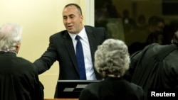 FILE - Kosovo's former prime minister, Ramush Haradinaj, is seen at his retrial at the International Criminal Tribunal for the former Yugoslavia in The Hague, Nov. 29, 2012.