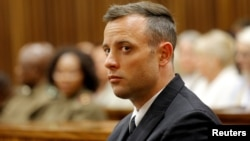 FILE - Former Paralympian Oscar Pistorius appears for sentencing for the murder of Reeva Steenkamp at the Pretoria High Court, South Africa, June 14, 2016.