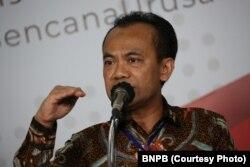 Sekretaris Kementerian Koordinator Perekonomian Susiwijono saat menggelar konferensi pers di Gedung BNPB, Jakarta, Kamis, 26 Maret 2020. (Foto: BNPB)