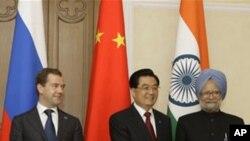 چین: د روسیې سره به یې د صادراتو په برخه کې اختلافات کم شي