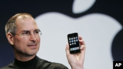 FILE - Apple CEO Steve Jobs holds up an Apple iPhone at the MacWorld Conference in San Francisco, California, Jan. 9, 2007.