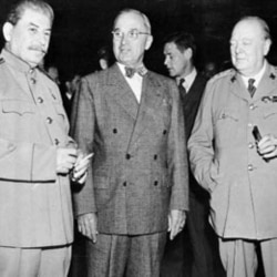 President Harry Truman, center, talks with Soviet leader Josef Stalin, left, and British Prime Minister Winston Churchill, at the Potsdam Conference near Berlin, on July 17,1945