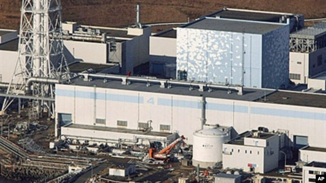 An aerial view shows the quake-damaged Fukushima nuclear power plant in the Japanese town of Futaba, Fukushima prefecture, Japan, run by Tokyo Electric Power, March 12, 2011