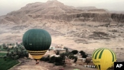 In this image made available by Christopher Michel, the launch site near Luxor in Egypt, shortly prior to a hot air balloon explosion, February 26, 2013.